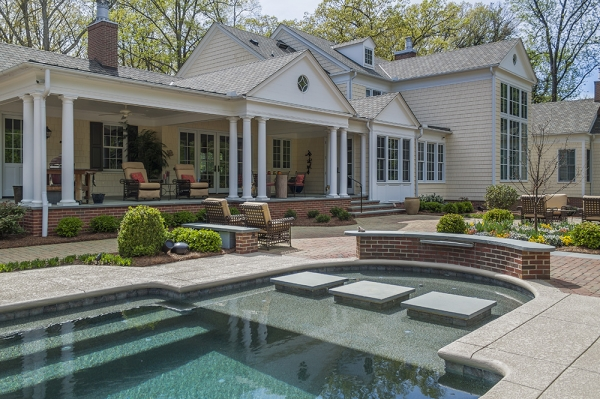 Exterior photo of the backyard and pool