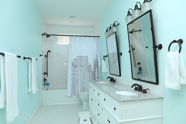Interior photo of the teal bathroom